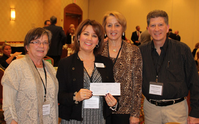 ICP leadership holding check from Community Memorial Foundation Challenge Grant