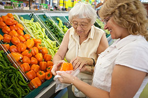Woman with senior grocery shopping