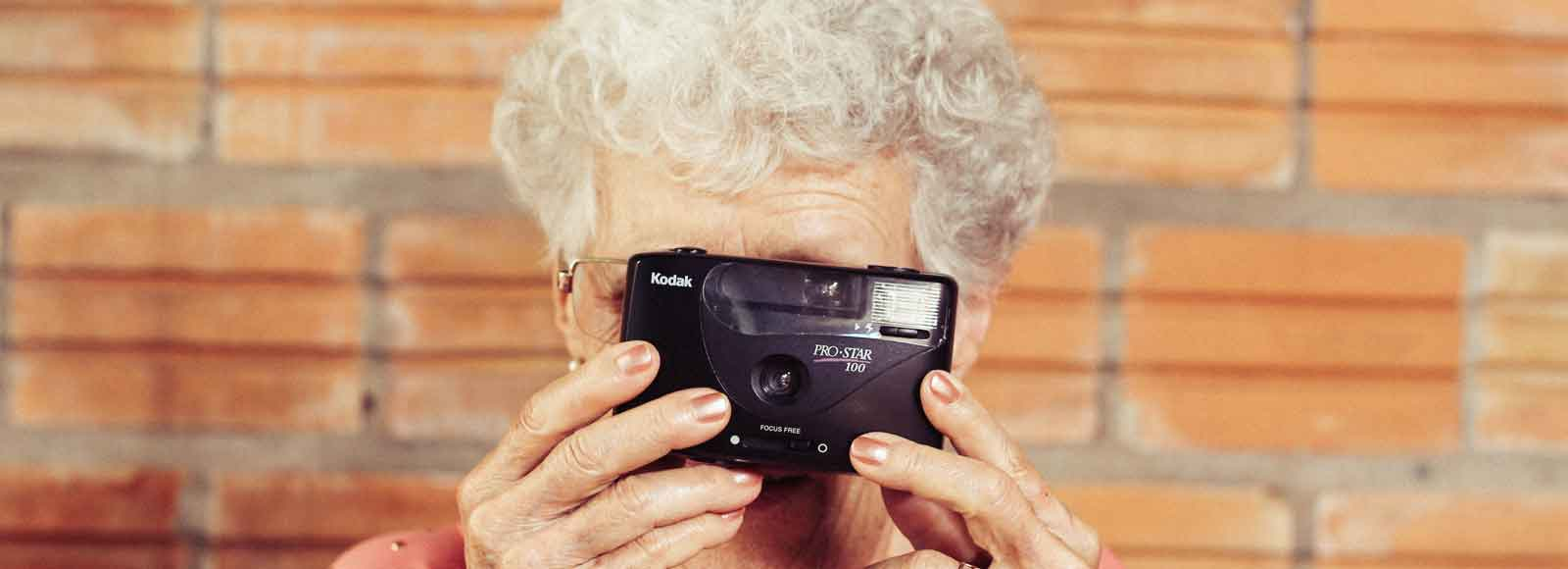 Older woman with a camera