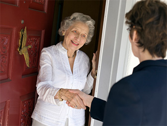 Elderly woman answering the door